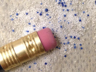 These small but way-too-mighty microbeads are now being phased out of toiletries for sale in Illinois. (O. Lyandres)