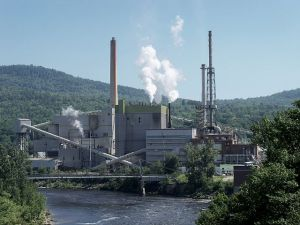 Paper bags are born in places like this riverside Maine paper mill. (Alexis Horatius)